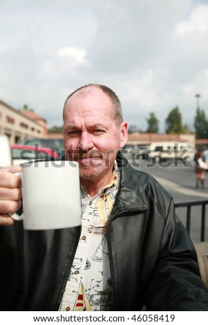 Middle Aged Businessman drinks coffee and has a conversation - stock photo