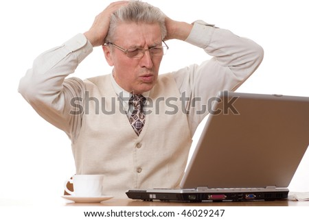 middle-aged businessman  holding his head