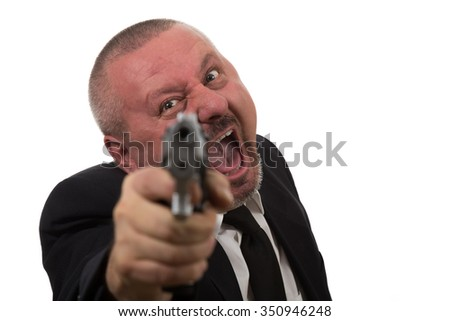 Middle aged businessman pointing gun isolated on white background - stock photo