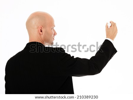 Middle aged businessman using marker - stock photo