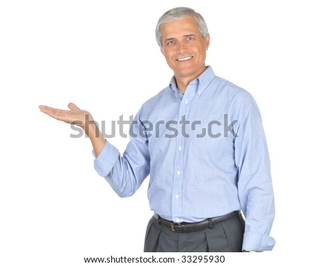 Middle Aged  Businessman Wearing Blue Shirt With Hand Extended Palm up isolated on white