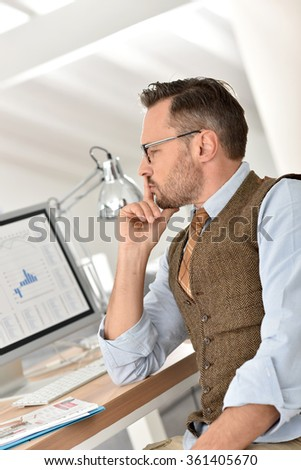 Middle-aged businessman with eyeglasses in office
