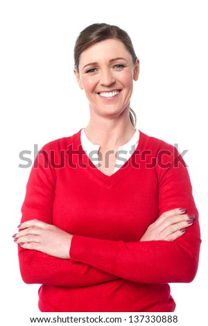 Middle aged casual lady posing with arms folded, isolated over white. - stock photo