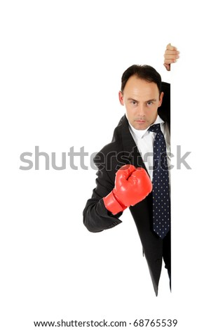 Middle aged caucasian businessman behind wall wearing red boxing glove. Copy space. Studio shot. White background. - stock photo