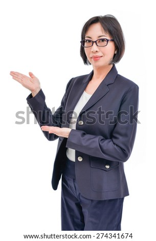 Middle aged corporate woman showing copy space to the camera, smiling warmly. - stock photo