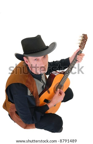 Middle aged country and western singer, man with traditional outfit posing with guitar.  White background