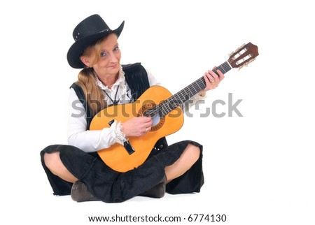 Middle aged country and western singer woman with traditional dress playing the  guitar. White background