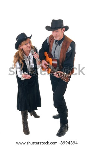 Middle aged country and western singers, woman and man with traditional outfit posing with guitar.  White background