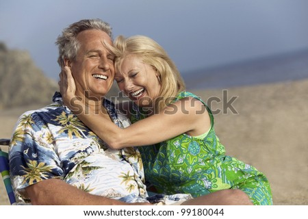 Middle-Aged Couple at Beach - stock photo