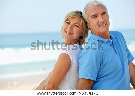 Middle-aged couple at the seaside - stock photo