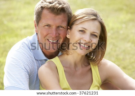 Middle aged couple having fun in countryside - stock photo