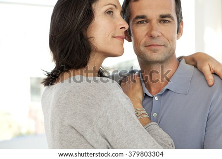 Middle-aged couple hugging - stock photo