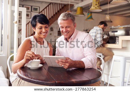 Middle aged couple in a cafe - stock photo