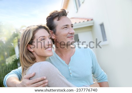 Middle-aged couple looking towards the future - stock photo