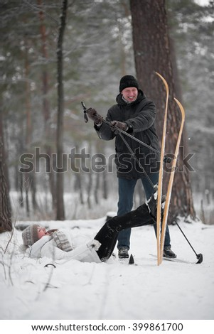 Middle aged couple on Ski in the forest having fun