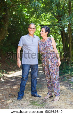 middle aged couple walking in the forest