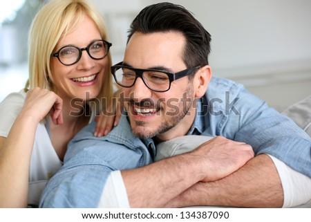 Middle-aged couple wearing eyeglasses - stock photo
