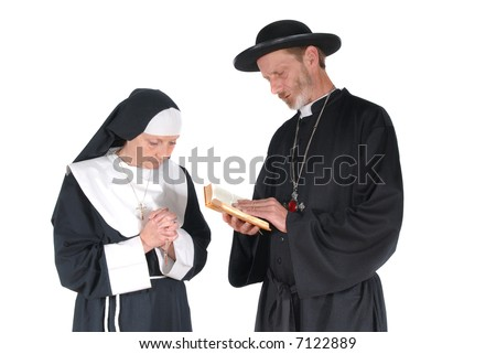 Middle aged devout nun and priest in deep thoughts, praying. Female hands crossed, male with bible in hand - stock photo