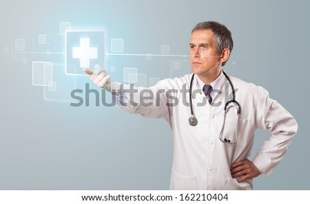 Middle aged doctor pressing modern medical type of button - stock photo