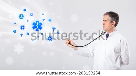 Middle aged doctor with blue medical icons - stock photo