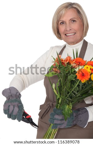 Middle-aged female florist - stock photo