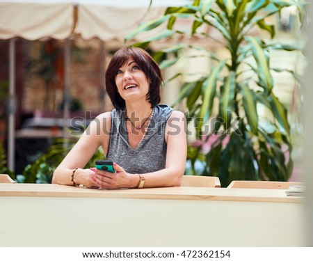 middle aged female using smartphone