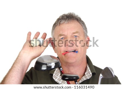 Middle aged golf player holding two used golf balls with tees in mouth.