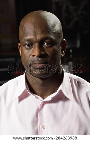 Middle-aged guy in pink shirt portrait - stock photo