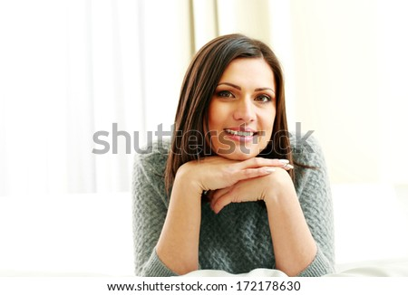Middle-aged happy woman looking at camera - stock photo