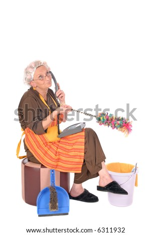 Middle aged housewife, cleaning lady with curlers in hair chatting on phone, gossiping
