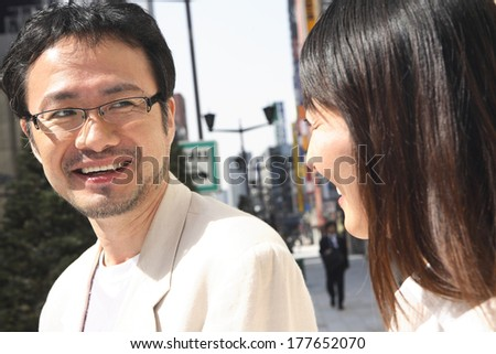 Middle - aged Japanese couple shopping in the city