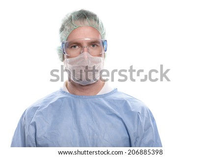 Middle-aged male nurse or doctor in surgical scrubs wearing a theatre gown, mask, goggles and a cap looking directly at the camera, head and shoulders isolated on white - stock photo