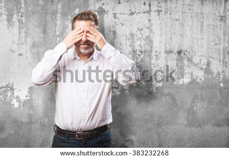 middle aged man covering his eyes