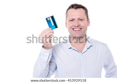 Middle aged man displaying his credit card.