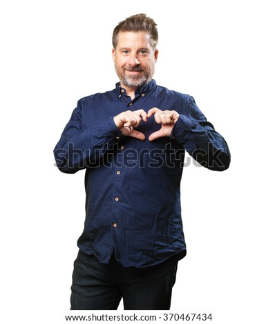 middle aged man doing a heart gesture - stock photo