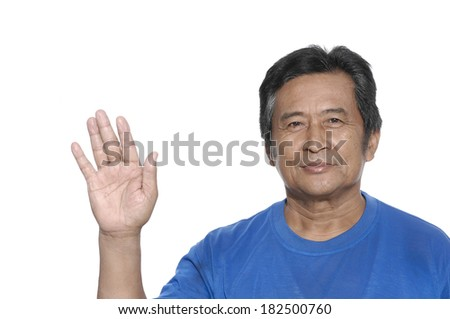 Middle Aged Man doing stop symbol