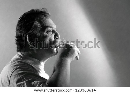 middle aged man drinking water from a glass - stock photo