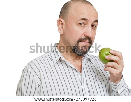 Middle aged man eating the apple, isolated on a white background