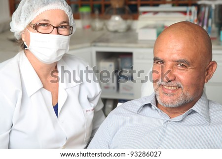 Middle aged man happy at the dentist - stock photo