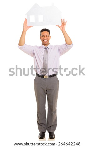 middle aged man holding paper house on white background
