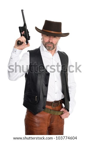 Middle aged man in a cowboy hat hold a gun. - stock photo