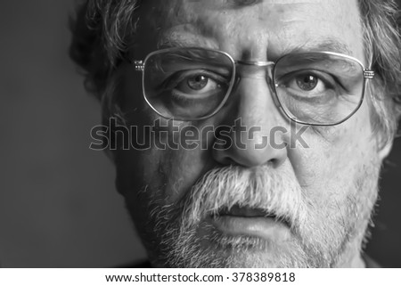 middle-aged man in eyeglasses, selective focus - stock photo