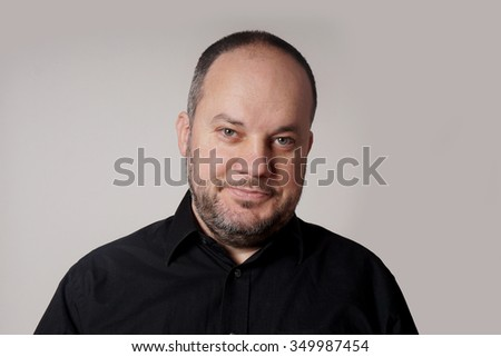 middle aged man in his forties with friendly expression         - stock photo