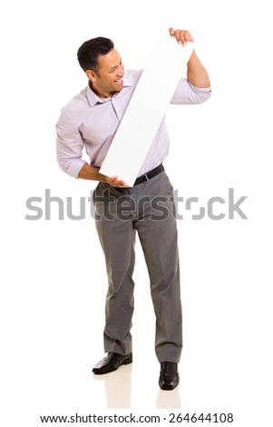 middle aged man looking at blank white board on white background - stock photo