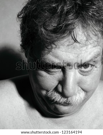 middle-aged man looks askance - stock photo