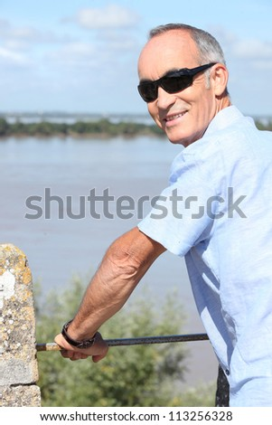 Middle-aged man on holiday abroad - stock photo