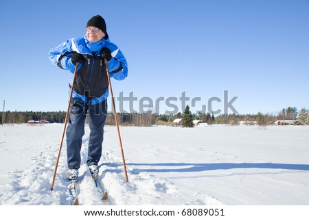 Middle-aged man skiing - stock photo