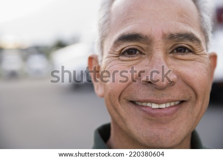 Middle-aged man smiling - stock photo