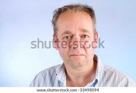 Middle-Aged Man Unhappy About Something - stock photo