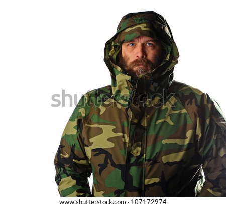 Middle aged man wearing a camouflage military rain coat isolated on a white background. - stock photo